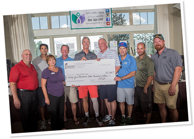 Orthopaedic Associates of St Augustine presenting a large check during charity event