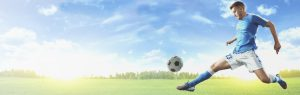 Guy kicking a soccer ball