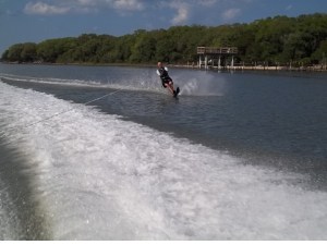 Guy wakeboarding on a river