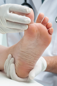 Doctor Examining Ingrown Toe Nail