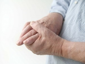 Person holding fingers in pain