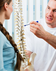 Doctor explaining spinal issue to a patient