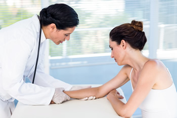 Doctor examining elbow injury