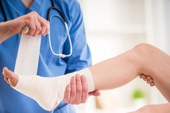St. Augustine foot doctor wrapping ankle injury